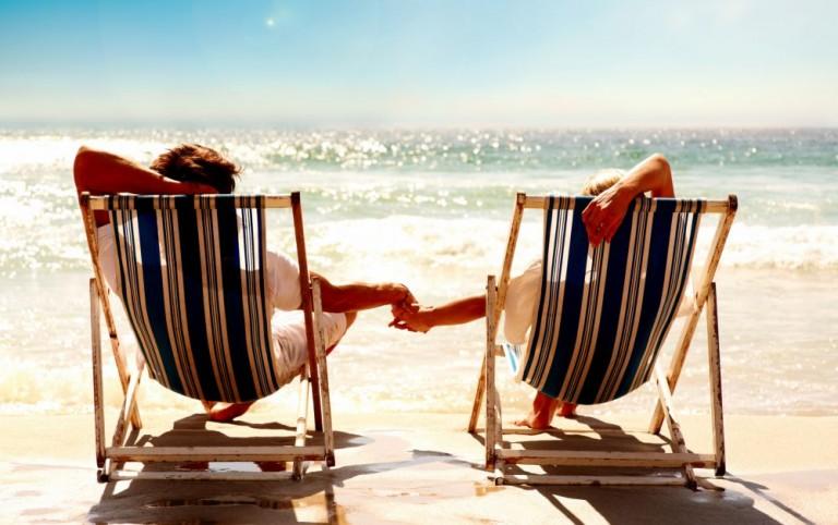 Strand to solstoler i Lanzarote - Kanariøyene